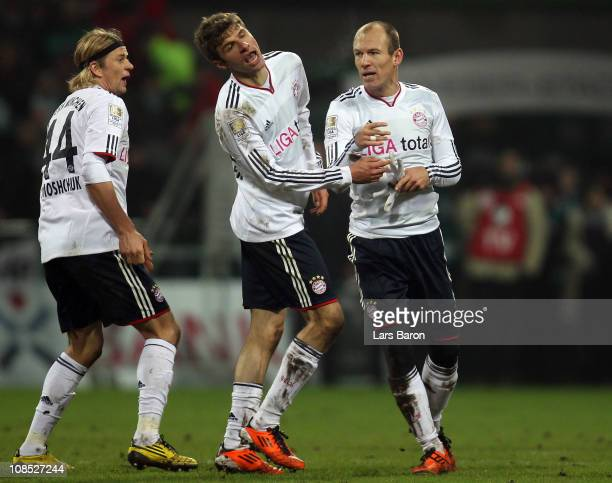 Arjen Robben of Muenchen argues with team mate Thomas Mueller after winning the Bundesliga match between SV Werder Bremen and FC Bayern Muenchen at...
