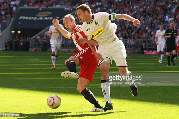 Arjen Robben of Muenchen battles for the ball with Filip Daems of Gladbach during the Bundesliga match between FC Bayern Muenchen and Borussia...
