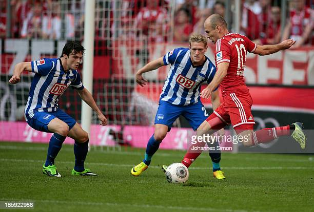 Arjen Robben of Muenchen battles for the ball with Nico Schulz and Johannes van Bergh of Berlin during the Bundesliga match between FC Bayern...