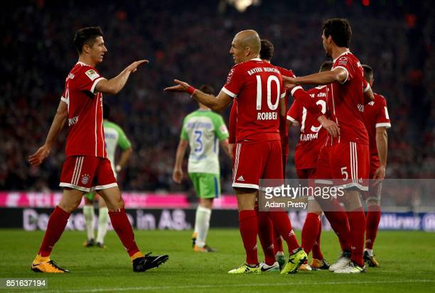 Arjen Robben of Muenchen celebrate with his team mates after he scores the 2nd goal during the Bundesliga match between FC Bayern Muenchen and VfL...