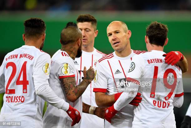 Arjen Robben of Muenchen celebrate with his team mates after he scores the 5th goal the DFB Cup quarter final match between SC Paderborn and Bayern...