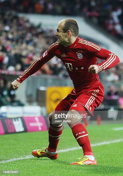 Arjen Robben of Muenchen celebrates after scoring his team's second goal during the Bundesliga match between FC Bayern Muenchen and SV Werder Bremen...