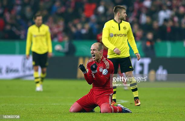 Arjen Robben of Muenchen celebrates after the DFB cup quarter final match between Bayern Muenchen and Borussia Dortmund at Allianz Arena on February...