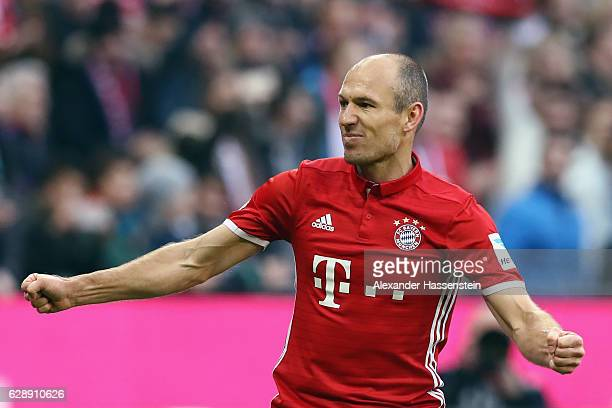 Arjen Robben of Muenchen celebrates his team's first goal during the Bundesliga match between Bayern Muenchen and VfL Wolfsburg at Allianz Arena on...