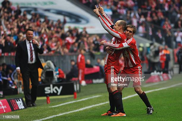 Arjen Robben of Muenchen celebrates his team's second goal with team mate Philipp Lahm during the Bundesliga match between FC Bayern Muenchen and...