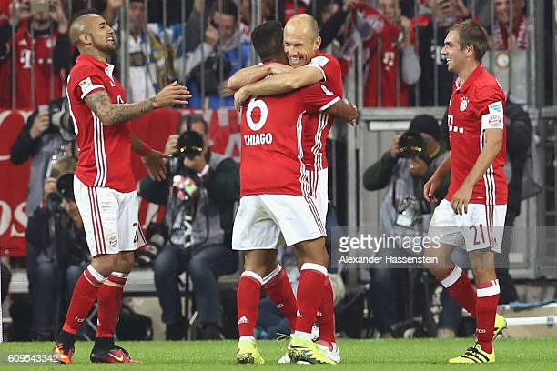 Arjen Robben of Muenchen celebrates scoring the 3rd team goal with his team mates Thiago Philipp Lahm and Arturo Vidal during the Bundesliga match...