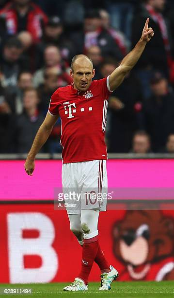Arjen Robben of Muenchen celebrates scoring the first goal during the Bundesliga match between Bayern Muenchen and VfL Wolfsburg at Allianz Arena on...