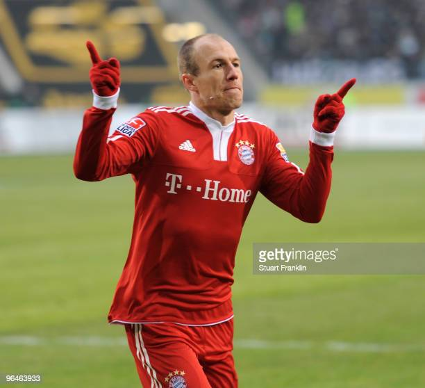 Arjen Robben of Muenchen celebrates scoring the first goal during the Bundesliga match between Vfl Wolfsburg and FC Bayern Muenchen at Volkswagen...