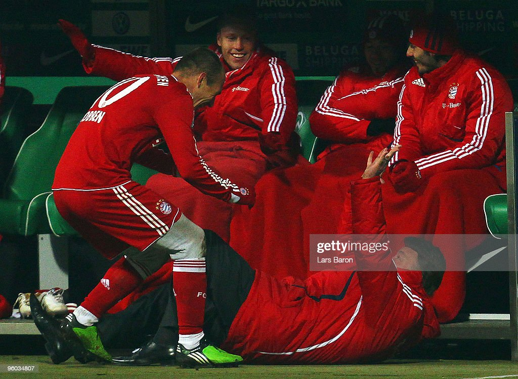 Arjen Robben of Muenchen celebrates with head coach Louis van Gaal after scoring his teams third goal during the Bundesliga match between SV Werder Bremen and FC Bayern Muenchen at Weser Stadium on January 23, 2010 in Bremen, Germany.