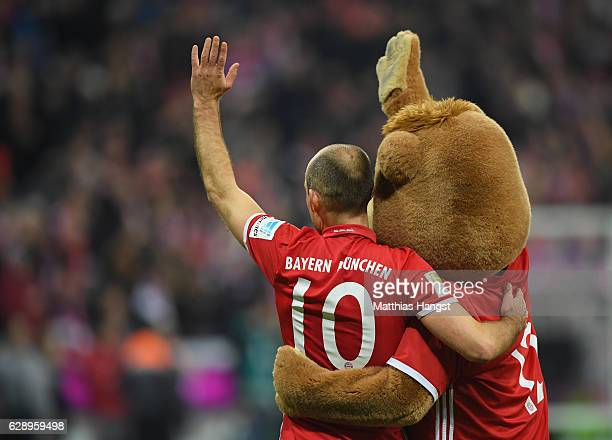 Arjen Robben of Muenchen celebrates with mascot Bernie after the Bundesliga match between Bayern Muenchen and VfL Wolfsburg at Allianz Arena on...
