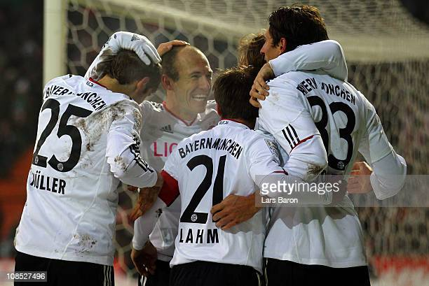 Arjen Robben of Muenchen celebrates with team mates after Per Mertesacker of Bremen scored a own goal during the Bundesliga match between SV Werder...