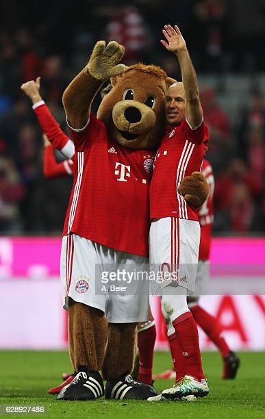 Arjen Robben of Muenchen celebrates with the club mascot Bernie at the end of the Bundesliga match between Bayern Muenchen and VfL Wolfsburg at...