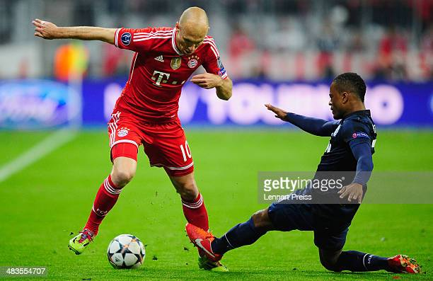 Arjen Robben of Muenchen challenges Patrice Evra of Manchester during the UEFA Champions League quarterfinal second leg match between FC Bayern...