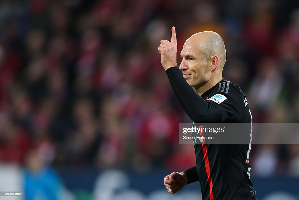 Arjen Robben of Muenchen gestures during the Bundesliga match between 1. FSV Mainz 05 and FC Bayern Muenchen at Coface Arena on December 19, 2014 in Mainz, Germany.