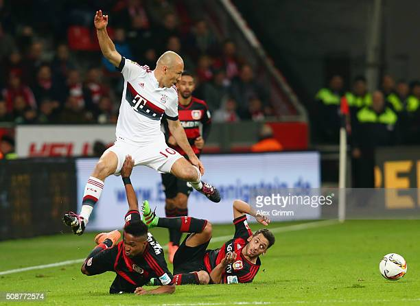 Arjen Robben of Muenchen is challenged by Wendell and Hakan Calhanoglu of Leverkusen during the Bundesliga match between Bayer Leverkusen and FC...
