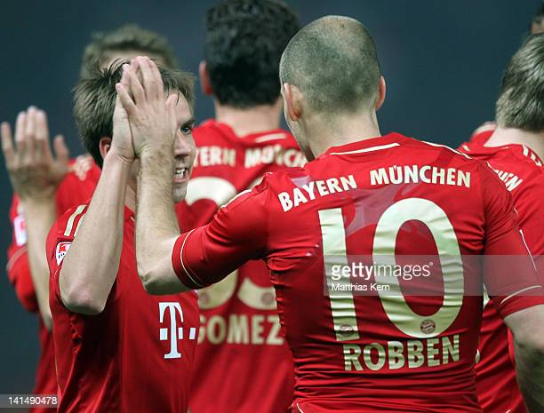 Arjen Robben of Muenchen jubilates with team mate Philipp Lahm after scoring the second goal during the Bundesliga match between Hertha BSC Berlin...