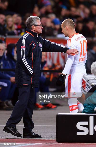Arjen Robben of Muenchen leaves the pitch next to head coach Jupp Heynckes during the Bundesliga match between Bayer 04 Leverkusen and FC Bayern...