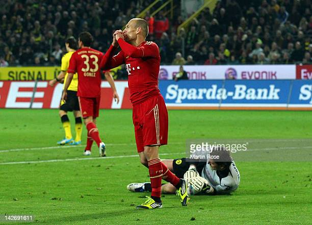 Arjen Robben of Muenchen reacts after he fails to score during the Bundesliga match between Borussia Dortmund and FC Bayern Muenchen at Signal Iduna...
