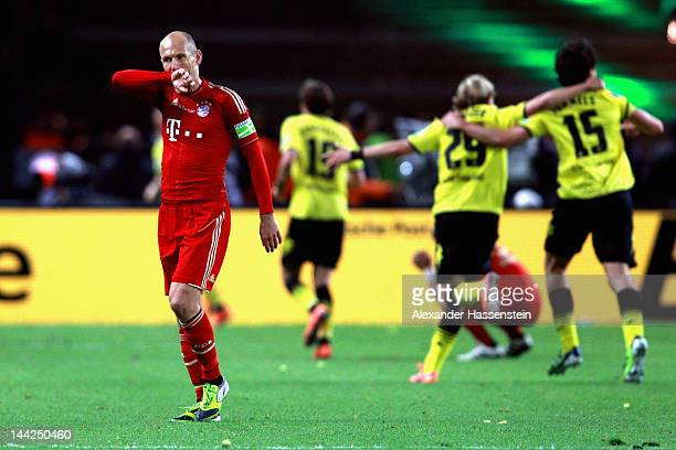 Arjen Robben of Muenchen reacts whilst players of Dortmund celebrates their 5th team goal during the DFB Cup final match between Borussia Dortmund...