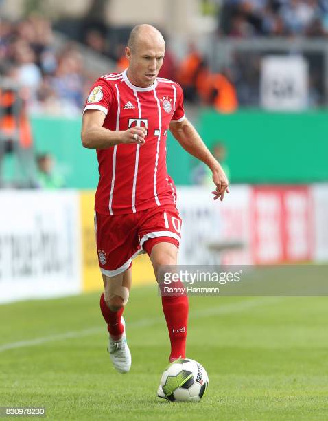 Arjen Robben of Muenchen runs with the ball during the DFB Cup first round match between Chemnitzer FC and FC Bayern Muenchen at community4you Arena...