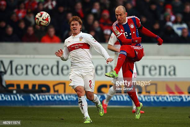 Arjen Robben of Muenchen scores his team's first goal against Gotoku Sakai of Stuttgart during the Bundesliga match between VfB Stuttgart and FC...