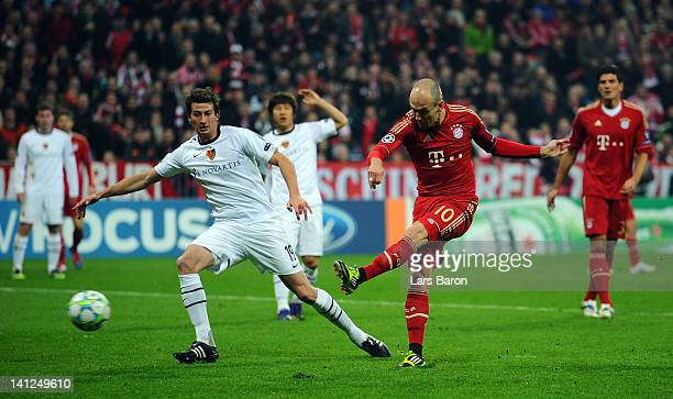 Arjen Robben of Muenchen scores his teams first goal during the UEFA Champions League Round of 16 second leg match between FC Bayern Muenchen and FC...