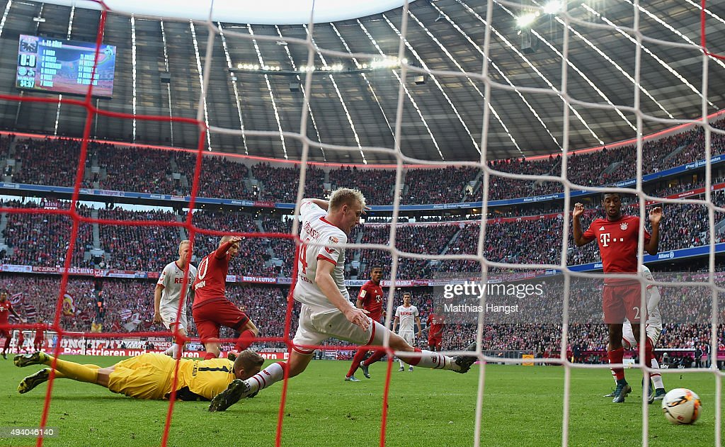 Arjen Robben of Muenchen scores his team's first goal past goalkeeper Timo Horn of Koeln during the Bundesliga match between FC Bayern Muenchen and 1. FC Koeln at Allianz Arena on October 24, 2015 in Munich, Germany.