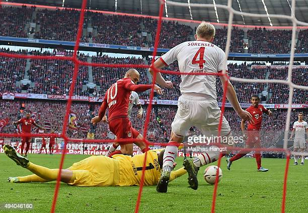 Arjen Robben of Muenchen scores his team's first goal past goalkeeper Timo Horn of Koeln during the Bundesliga match between FC Bayern Muenchen and...