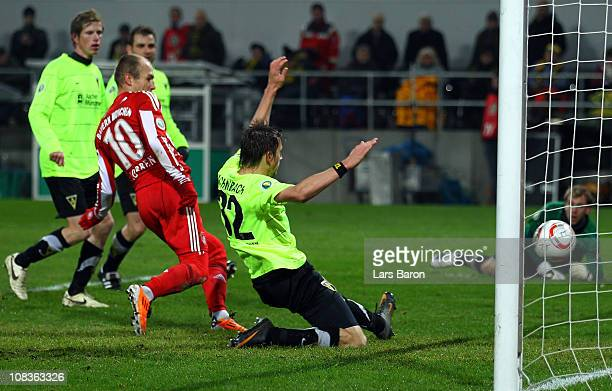 Arjen Robben of Muenchen scores his teams fourth goal during the DFB Cup quarter final match between Alemannia Aachen and Bayern Muenchen at Tivoli...