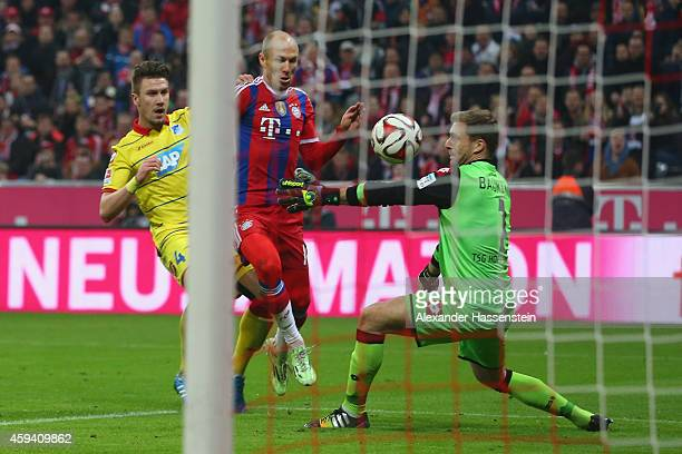 Arjen Robben of Muenchen scores the 3rd team goal against Oliver Baumann keeper of Hoffenheim during the Bundesliga match between FC Bayern Muenchen...