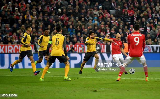 Arjen Robben of Muenchen scores the opening goal during the UEFA Champions League Round of 16 first leg match between FC Bayern Muenchen and Arsenal...
