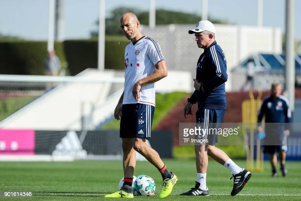 Arjen Robben of Muenchen speaks with Head coach Jupp Heynckes of Muenchen during the FC Bayern Muenchen training camp at Aspire Academy on January 04...