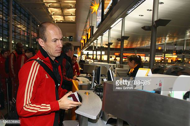 Arjen Robben of Muenchen waits for his team's departure to the training camp in Doha at Munich airport on January 2 2012 in Munich Germany