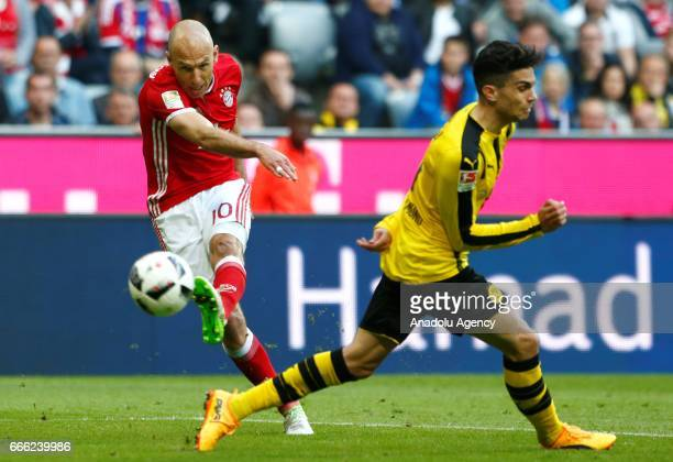 Arjen Robben of Munich and Marc Bartra of Dortmund fight for the ball during the German Bundesliga soccer match between Bayern Munich and Borussia...