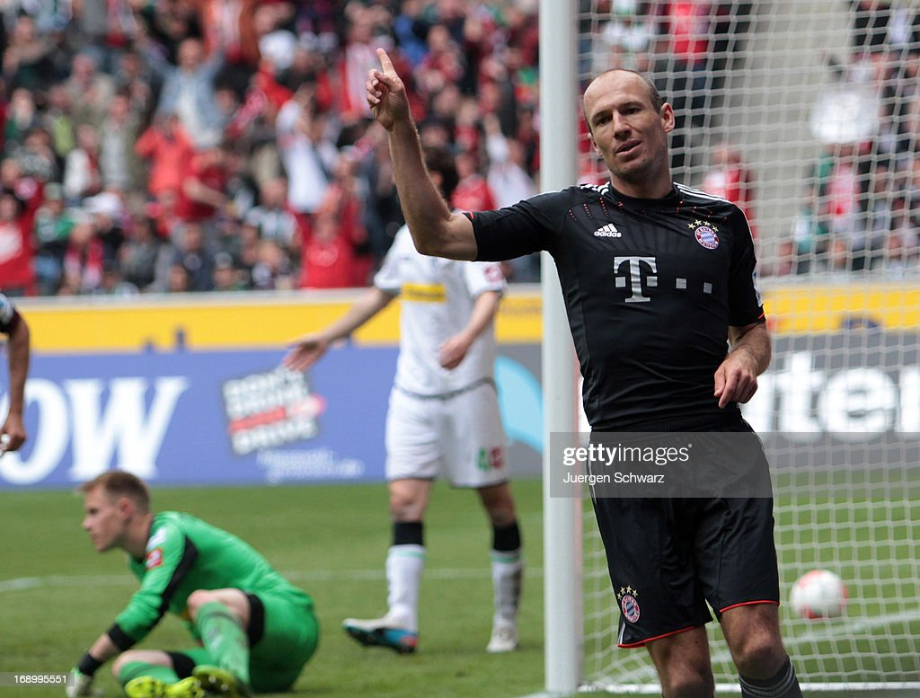 Arjen Robben of Munich celebrates after scoring during the Bundesliga match between Borussia Moenchengladbach and Bayern Muenchen at Borussia Park Stadium on May 18, 2013 in Moenchengladbach, Germany.
