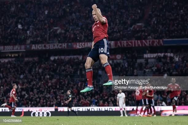Arjen Robben of Munich celebrates the opening goal for Munich during the Bundesliga match between FC Bayern Muenchen and FC Augsburg at Allianz Arena...