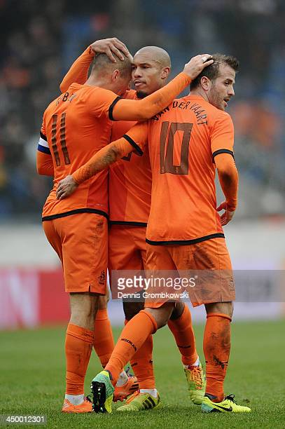Arjen Robben of Netherlands celebrates the second goal with teammates Rafael van der Vaart and Nigel de Jong during the International Friendly match...