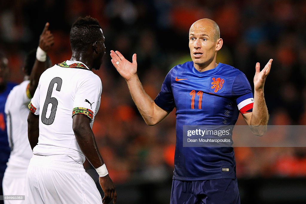 Arjen Robben of Netherlands speaks to a team mate during the International Friendly match between Netherlands and Ghana at De Kuip on May 31, 2014 in Rotterdam, Netherlands.