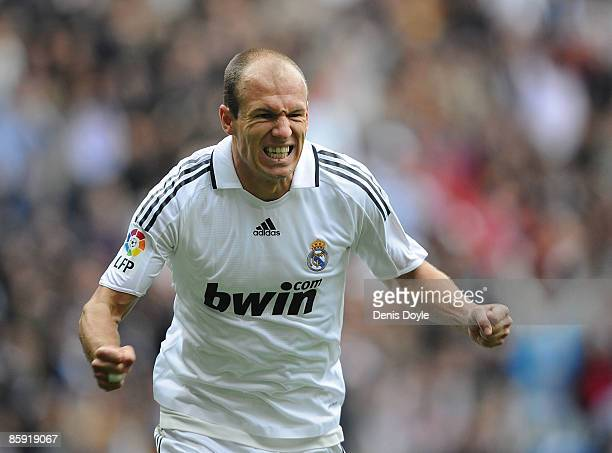 Arjen Robben of Real Madrid celebrates after scoring Real's second goal during the La Liga match between Real Madrid and Valladolid at the Santiago...