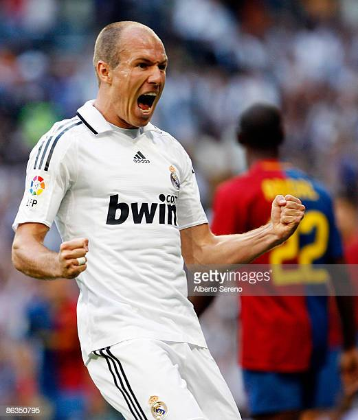 Arjen Robben of Real Madrid reacts after the first goal of his team during the La Liga match between Real Madrid and FC Barcelona at the Santiago...