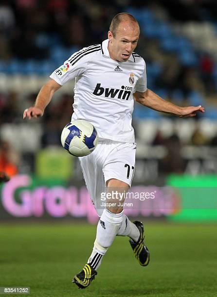 Arjen Robben of Real Madrid runs with the ball during the La Liga match between Almeria and Real Madrid at the Estadio de los Juegos Mediterraneos on...