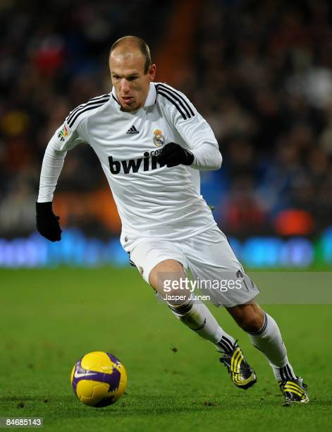 Arjen Robben of Real Madrid runs with the ball during the La Liga match between Real Madrid and Racing Santander at Santiago Bernabeu stadium on...