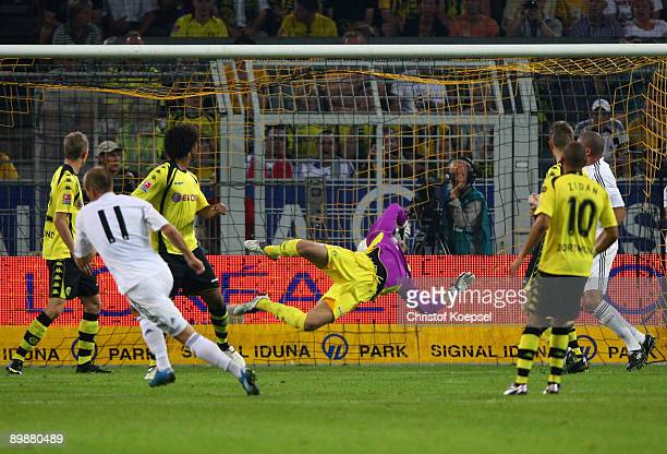 Arjen Robben of Real Madrid scores the second goal during a friendly match between Borussia Dortmund and Real Madrid at the Signal Iduna Park on...