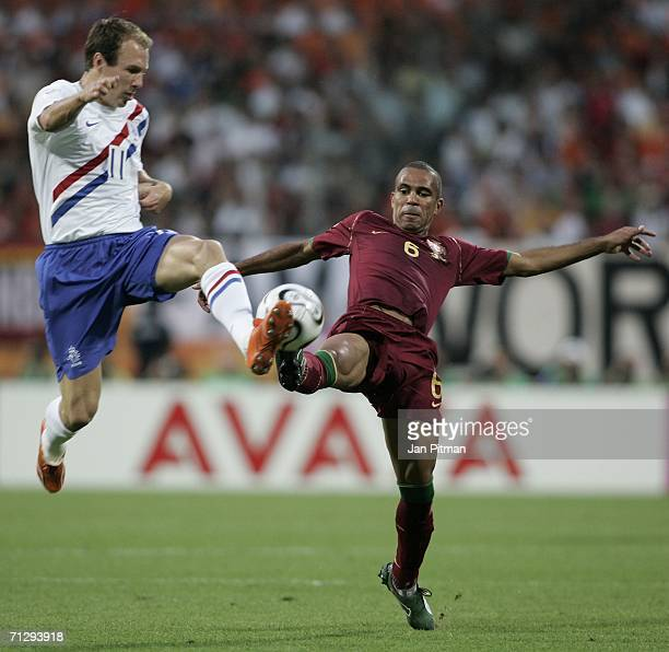 Arjen Robben of the Netherlands and Costinha of Portugal compete for the ball during the FIFA World Cup Germany 2006 Round of 16 match between...