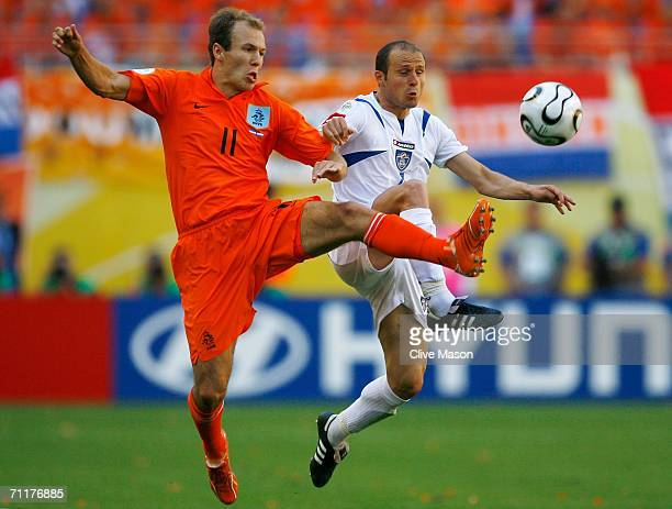 Arjen Robben of the Netherlands battles for the ball with Igor Duljaj of Serbia and Montenegro during the FIFA World Cup Germany 2006 Group C match...