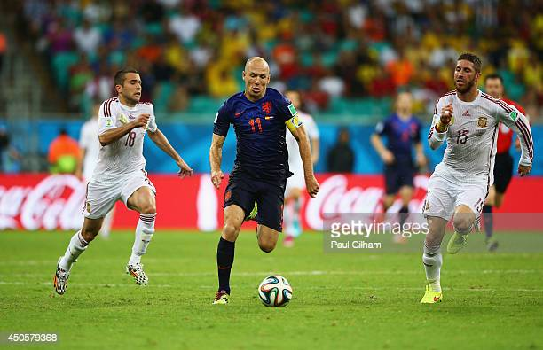 Arjen Robben of the Netherlands beats Sergio Ramos and Jordi Alba during the 2014 FIFA World Cup Brazil Group B match between Spain and Netherlands...