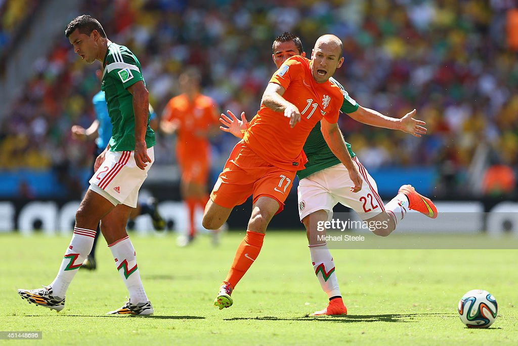 Arjen Robben of the Netherlands bursts between Paul Aguilar and Francisco Rodriguez of Mexico during the 2014 FIFA World Cup Brazil round of 16 match between Netherlands and Holland at Arena Castelao on June 29, 2014 in Fortaleza, Brazil.