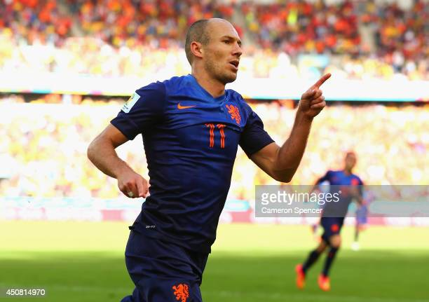 Arjen Robben of the Netherlands celebrates after scoring his team's first goal during the 2014 FIFA World Cup Brazil Group B match between Australia...