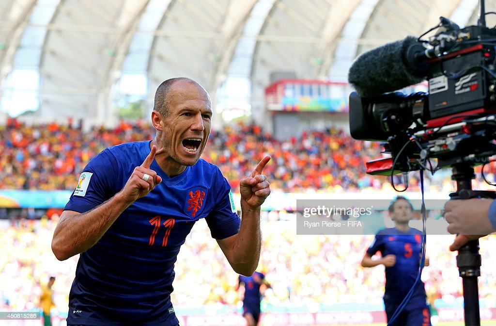 Arjen Robben of the Netherlands celebrates after scoring the team's first goal during the 2014 FIFA World Cup Brazil Group B match between Australia and Netherlands at Estadio Beira-Rio on June 18, 2014 in Porto Alegre, Brazil.