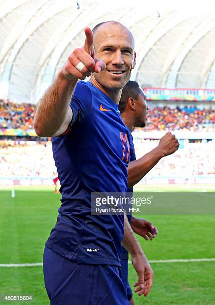 Arjen Robben of the Netherlands celebrates after scoring the team's first goal during the 2014 FIFA World Cup Brazil Group B match between Australia...